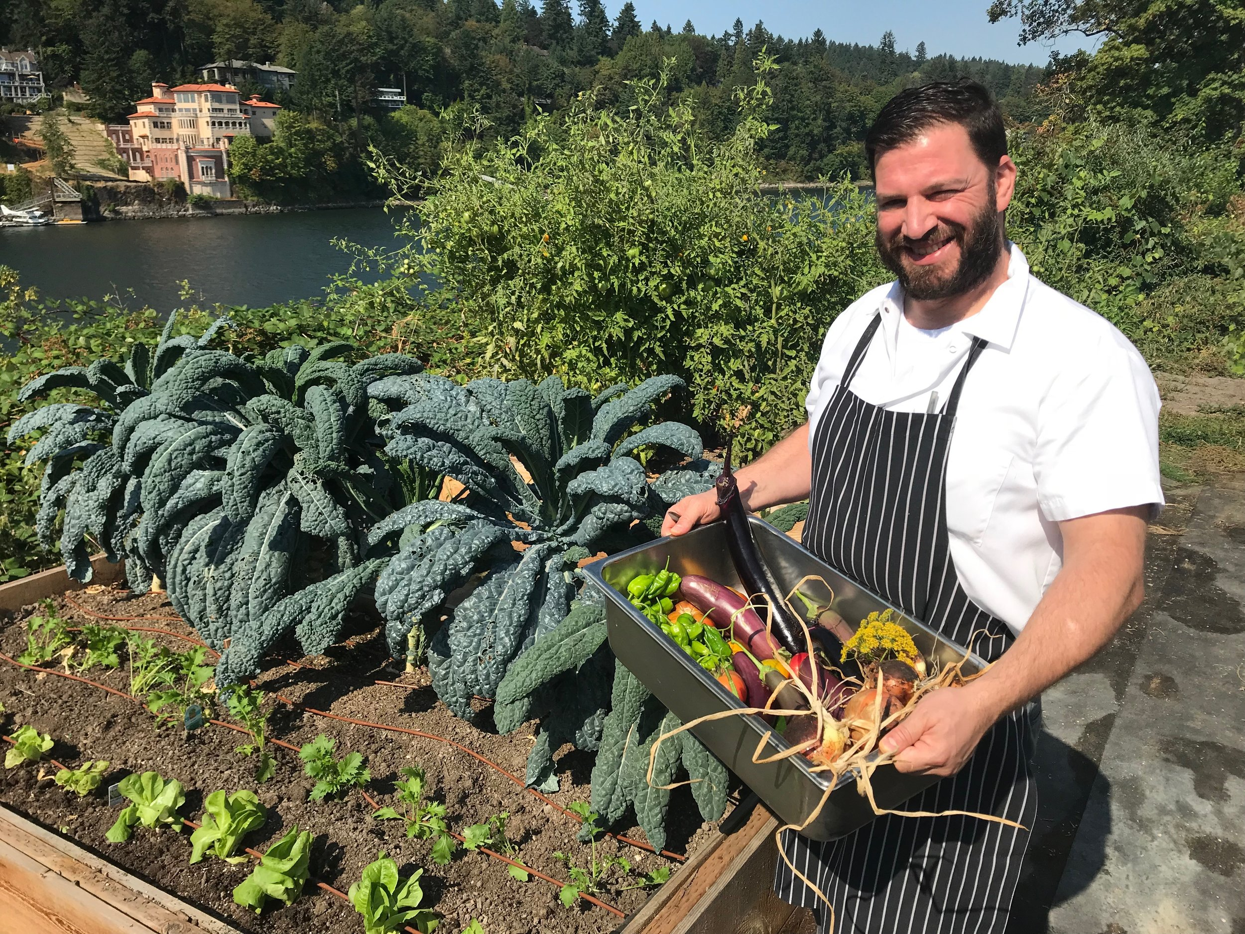 Executive Chef Nadav Bashan with a harvest for the Waverly kitchen
