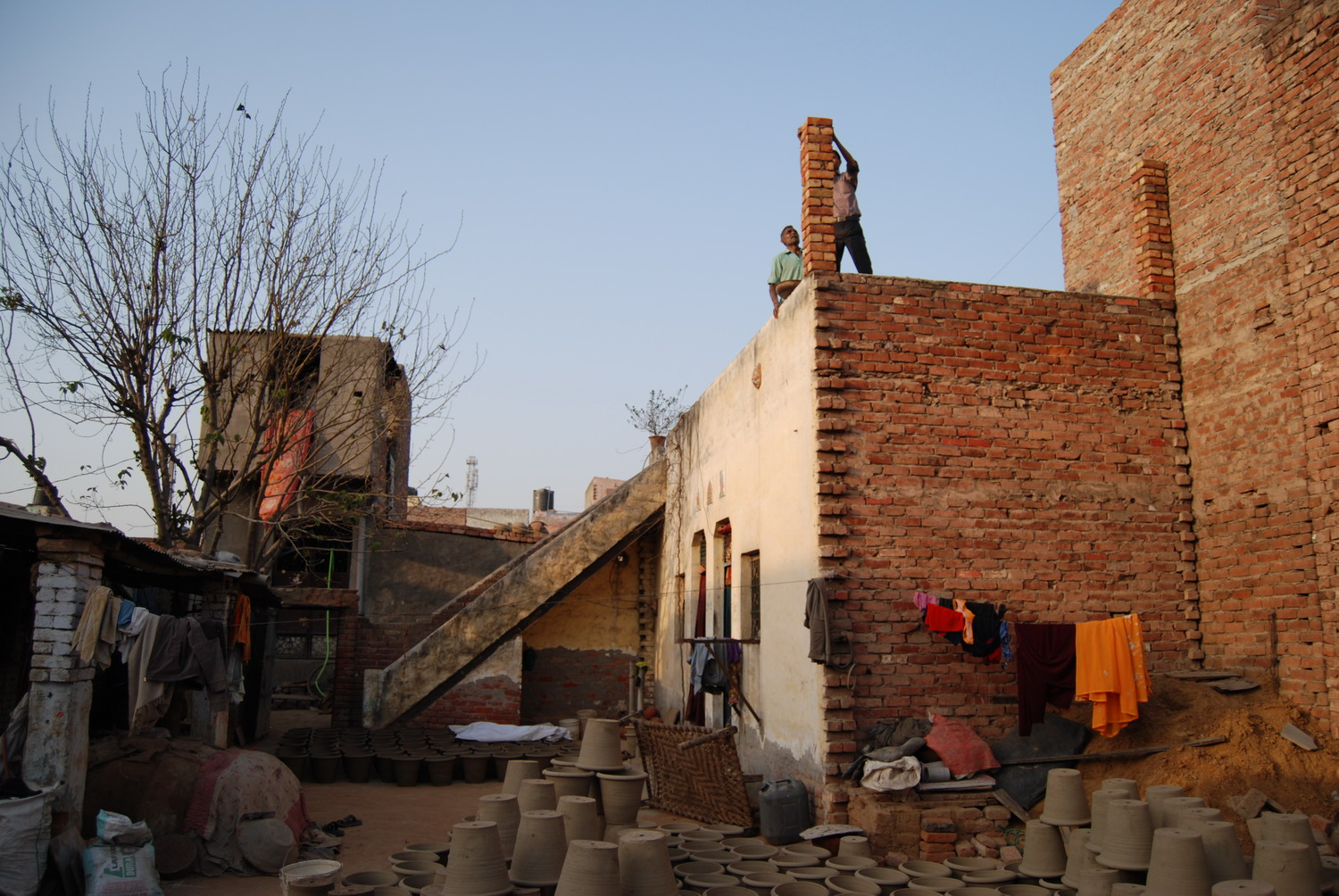 Manohar Lal and nephew creating a rooftop workshop