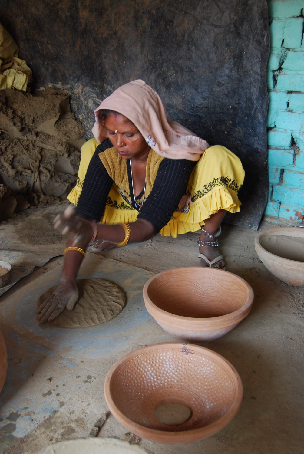 Vidya Devi making stack element from mould.