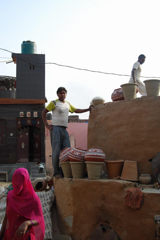 Anju Devi, Poppi and Manohar Lal stacking the kiln.