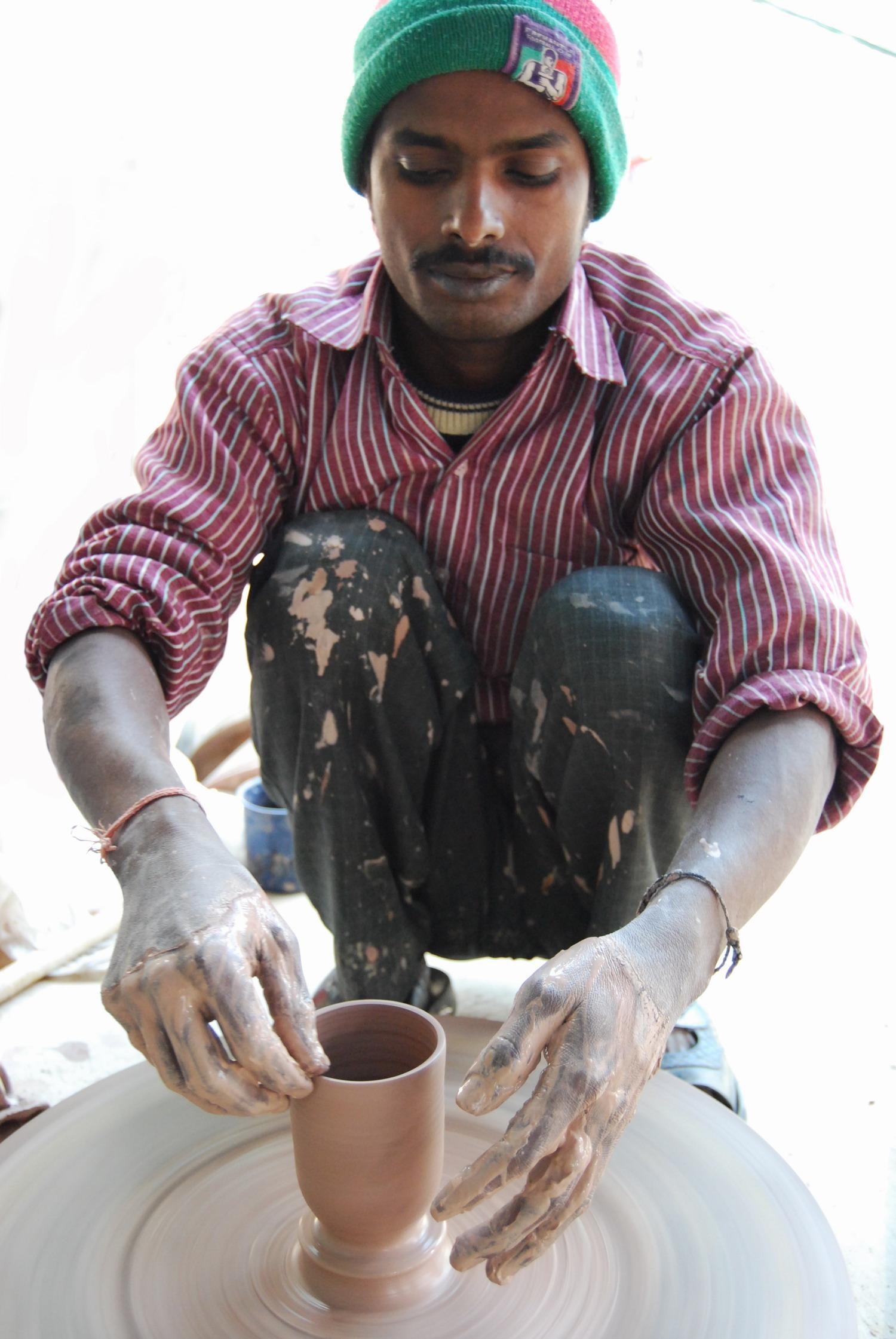 Banay Singh making beakers.