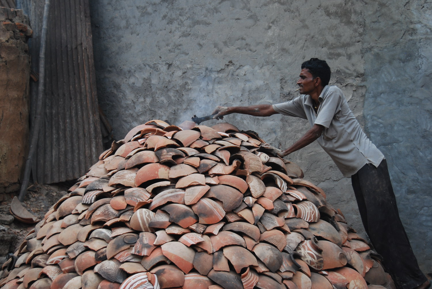 The coals are dropped into the kiln.