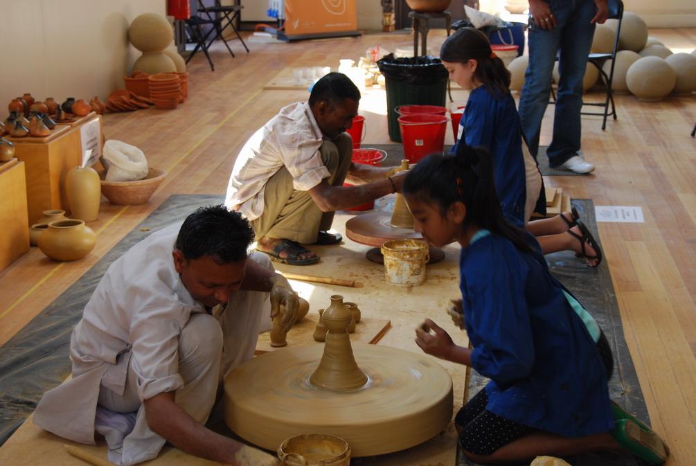 Artplay students making pots.jpg