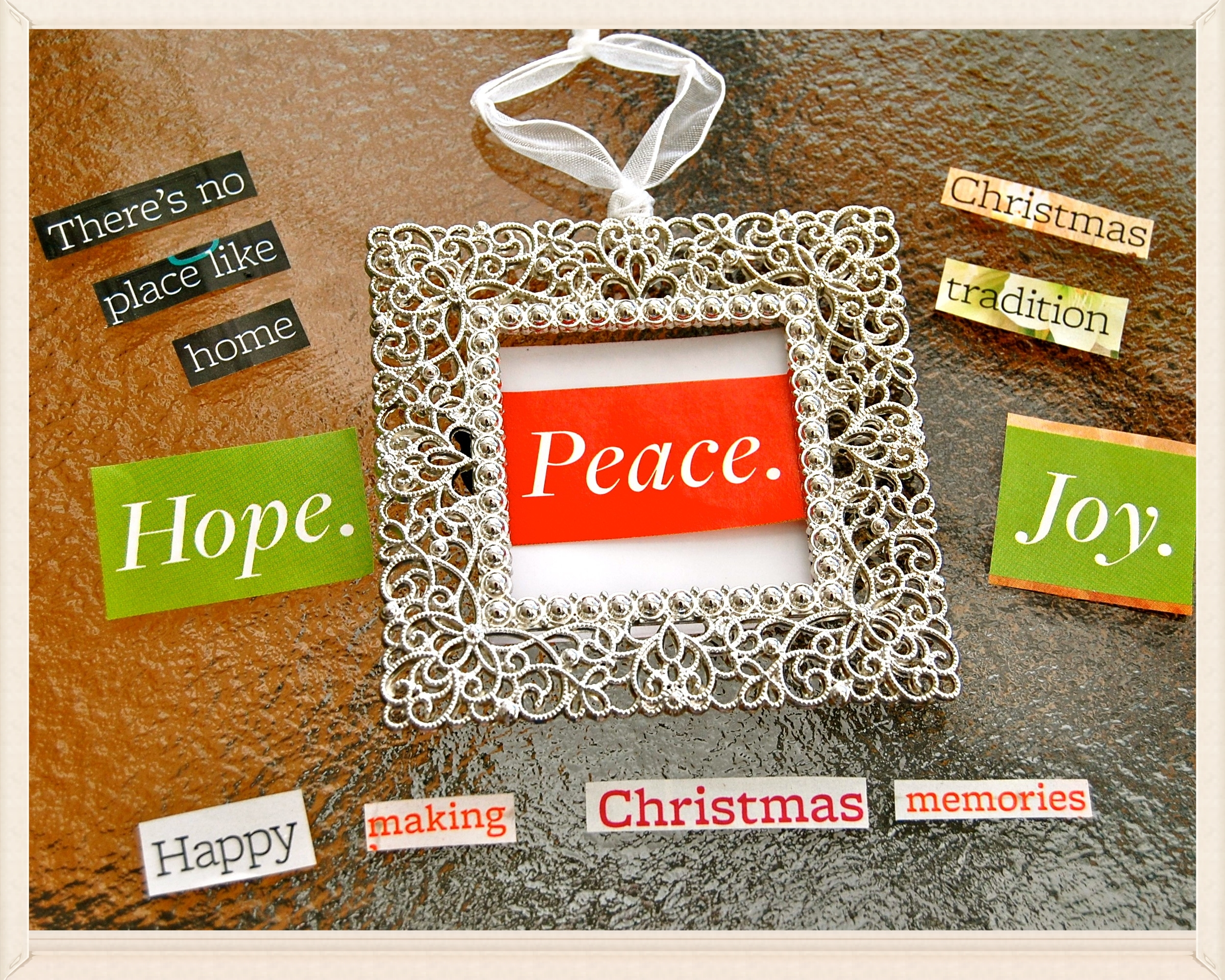 The 'waiting to become'...   small ornament photo frame . magazine clippings . thoughts of nearest/dearest ♥