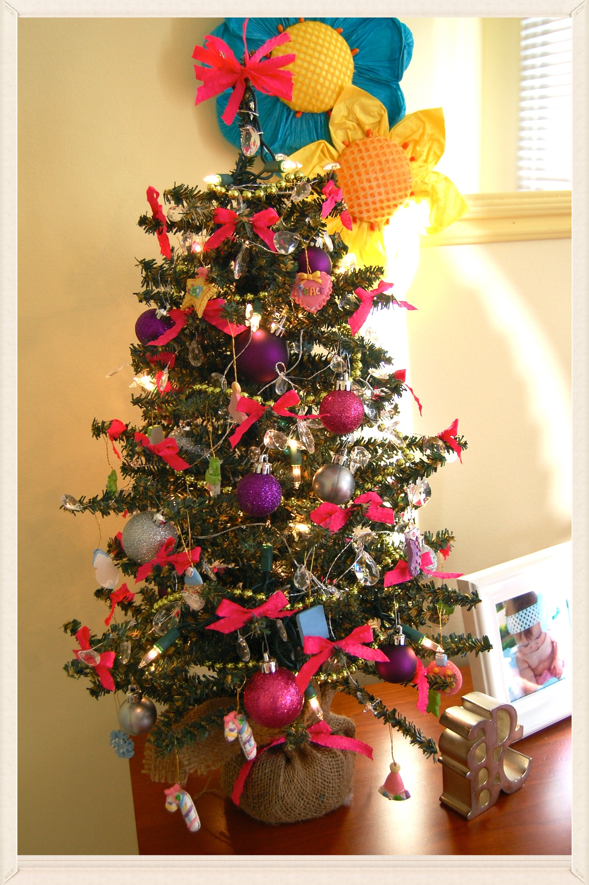 Lucy's princess tree ♥    small Christmas tree . hot pink satin ribbon . jewel garland . green, beaded garland . sparkly balls . miniature ornaments   *I'm not sure who is enjoying this one more