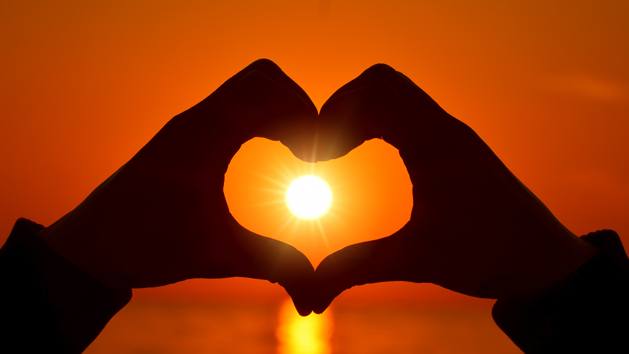 Love_Sunrises_and_sunsets_Fingers_Hands_Heart_Sun_532758_2048x1152.jpg