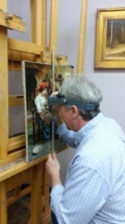 Joe Abbrescia in his art restoration studio located in Kalispell Montana