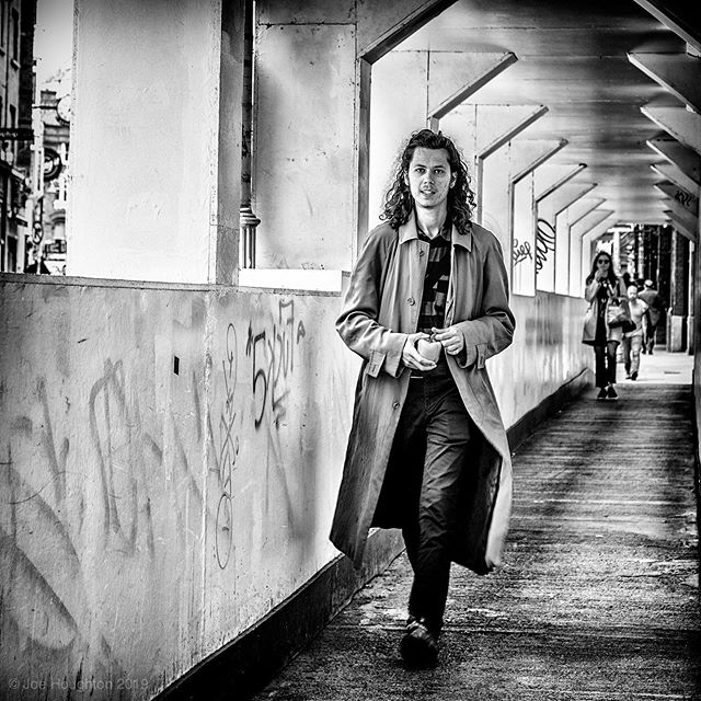Tunnel style.  Economic shoots are well and truly flourishing in Dublin, with a lot of construction throwing up temporary walkways and tunnels.  These are good hunting grounds for street photography, with side lighting, converging lines and hopefully a good subject coming into frame - like this stylish guy, pepper in hand who caught my eye just as I took the shot. Fuji XT-2, 1/60th sec, f/4, ISO 200, 75mm  All constructive comment and critique welcome!  A selection of my street photography images are available for sale online at https://houghtonphoto.darkroom.tech #fujixt-2 #ilovefujix #dublindaily #dailydublin #interiordecor #corporateart #dublinart #businessart #igerstreets #streetshared #fujifilm_street #BNW_PLANET_2019 #bnwgreatshots #photographyisart #houseoftones #monochrome #bnw_captures #blackandwhitephotography #bnw_life #bw_lover #bnw_planet #monoart #bw_society #bw_photooftheday #instablackandwhite #insta_bw #bnwmood #monochromatic #createcommune