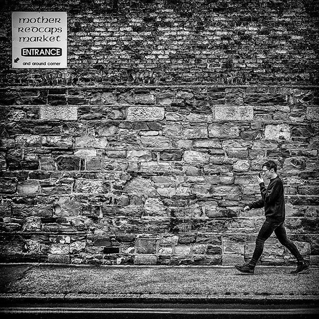 Mother Redcaps.  It was initially the wonderful textures of the wall that drew my attention, and then it was just a matter of waiting for someone suitable to walk into frame, which this chap obligingly did a couple of minutes later.  Fuji X100s, 1/1000th sec, f/4, ISO1250, 23mm. All constructive comment and critique welcome!  A selection of my street photography images are available for sale online at http://www.totpics.com/Images-for-Sale/Dublin/Street-Photography  #fujifilm  #fujix100s #funjifilmx100s #dublindaily  #dailydublin #igersstreets #justgoshoot #bnwgreatshots #yngkillers #urbanandstreet #meistershots #fatalframes #streetshared #streetmagazine #instaireland #discoverdublin #spicollective #SPiBnW #streetshots  #dublinisblackandwhite