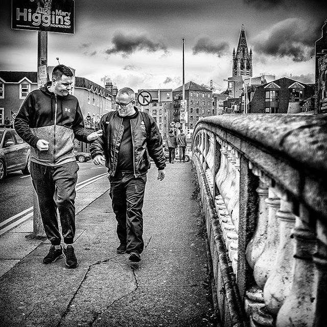 On Father Mathew Bridge... Having a good old chat as they passed me on the bridge, these two characters caught my eye and begged o be captured.  Fuji X100s, 1/1000th sec, f/2, ISO 800, 23mm.  #fujifilm #fujix100s #fujiblackandwhite #fujifilmblackandwhite #igersstreets #justgoshoot #bnwgreatshots #yngkillers #urbanandstreet #meistershots #fatalframes #streetshared #streetmagazine #instaireland #discoverdublin #dublindaily #spicollective #SPiBnW #streetphotography #streetshots