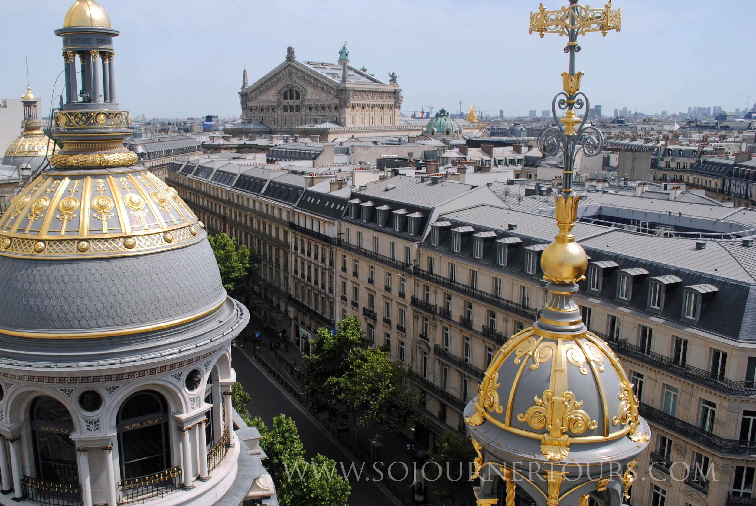 Seeing the Paris skyline from a roof-top cafe.
