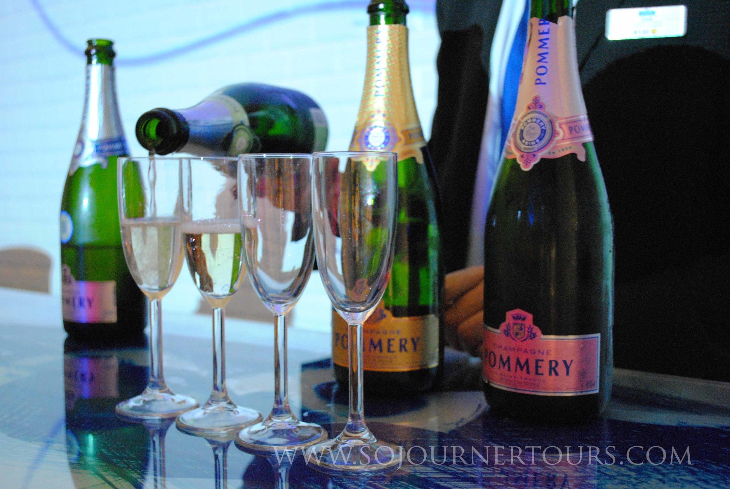 Sampling some champagne.