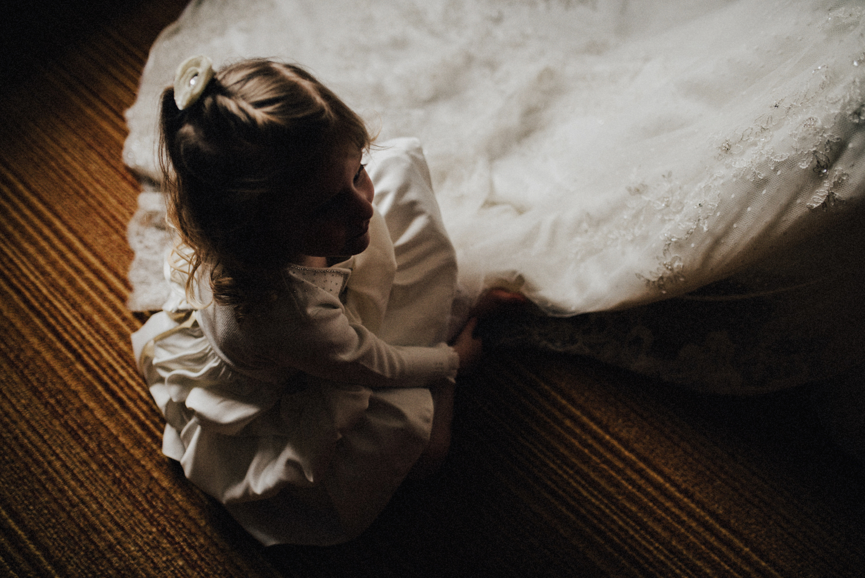 Flower Girl admiring Brides Dress
