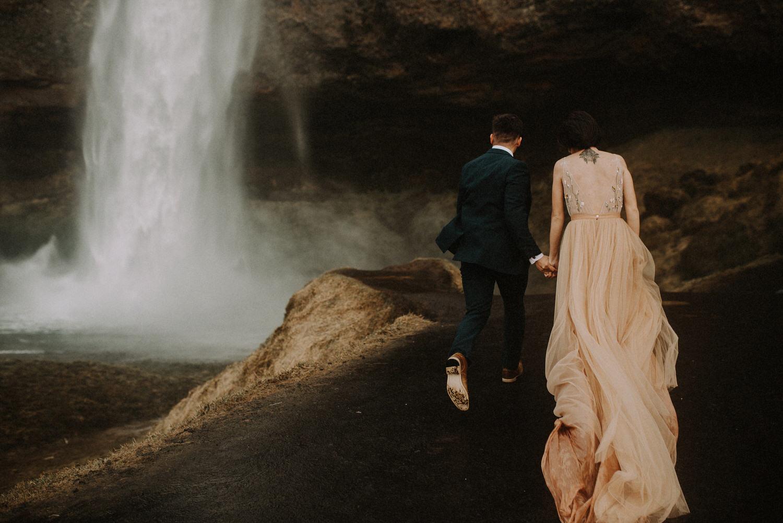 Iceland Elopement / Sumarokova Atelier Wedding Dress / Seljalandsfoss Waterfall