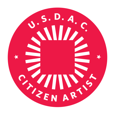 (Note: One need not be a legal citizen of the U.S. to be a Citizen Artist with the USDAC. Or an artist, for that matter!)