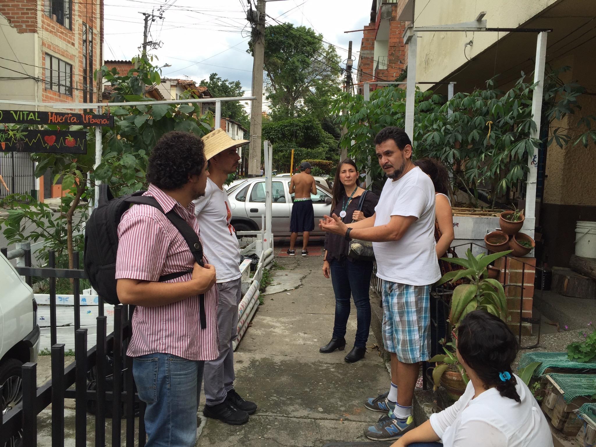 Javier Cardona showing visitors his garden, Espacio Vital