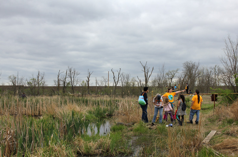 Volunteers receive instructions at  Haskell's 1  st   Annual Wetland Restoration Day .