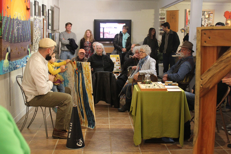 Poet Topher Enneking reads at the opening for  Heating Up: Artists Respond to Climate Change.