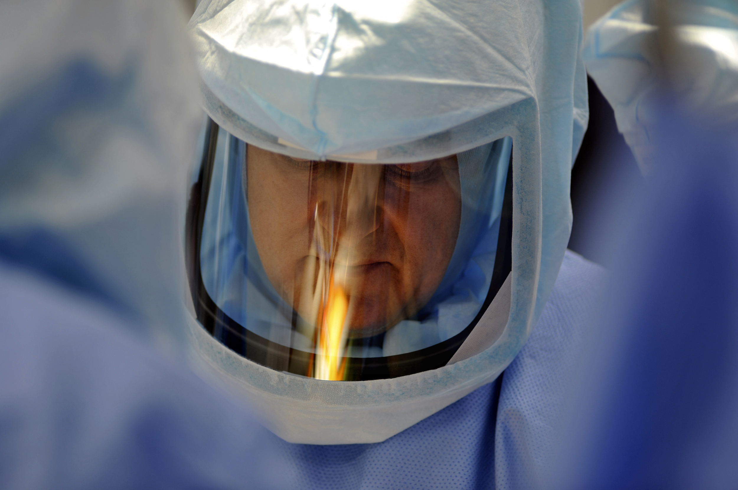 Dr. Bernasek, with the Ioban reflected in his face shield, is about to make the incision.