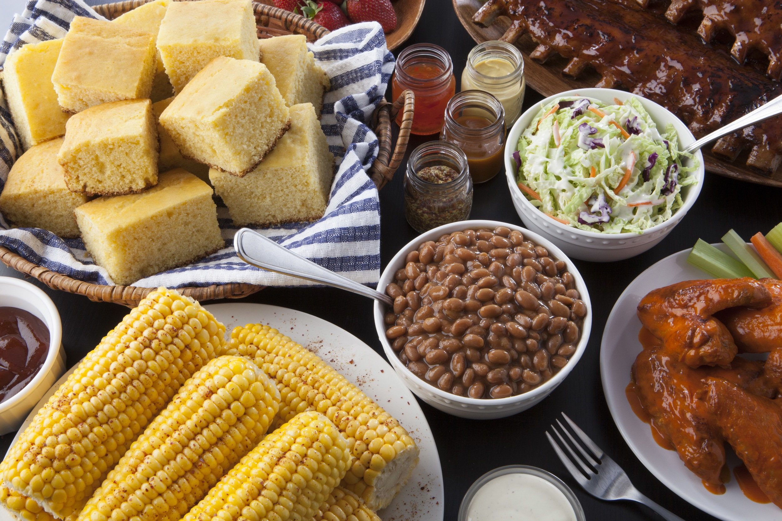 AAA Auto Insurance Commercial.  BBQ Corn, Chicken Wings, Bushes Baked Beans, Cole Slaw, Corn Bread sides.