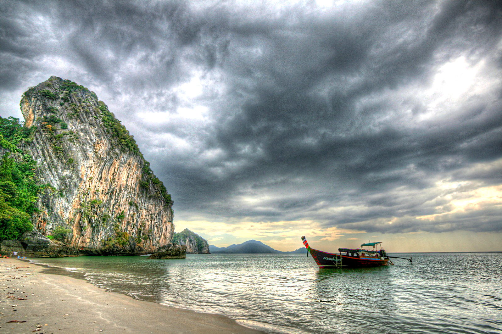 Long tail boat Thailand sky.jpg