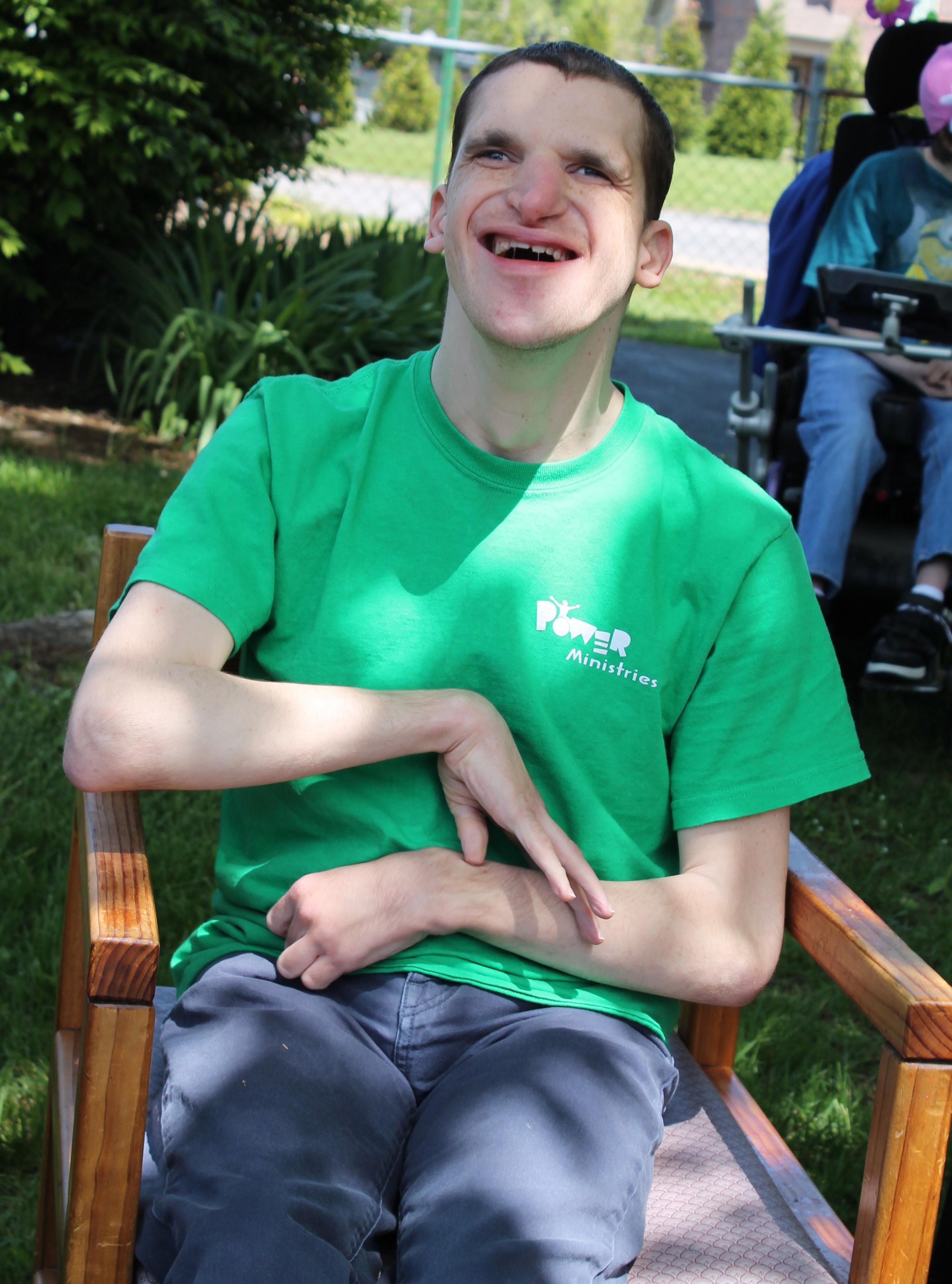 Nick enjoys the courtyard at Rauch's Fairmont Neighborhood Center