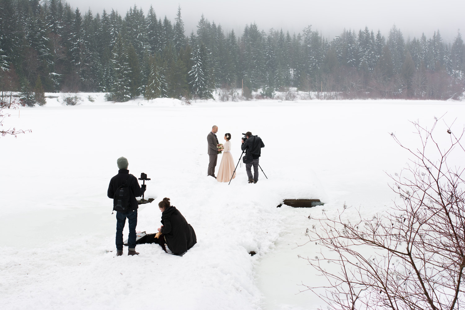 The wedding took place at the picturesque Nita Lake Lodge. We set up most of the shots on a tiny dock on the frozen lake. Adam even had to risk falling through the ice in order to get the shots.