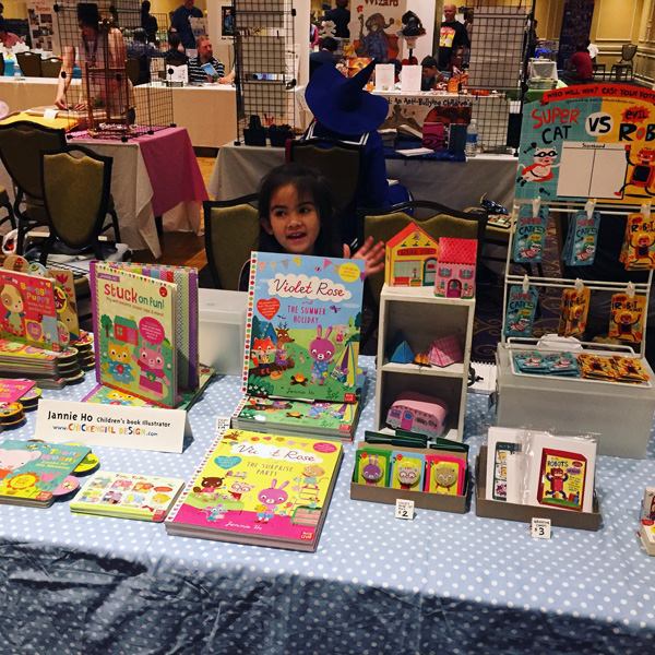 My little helper at my table at KIDS CON New England.