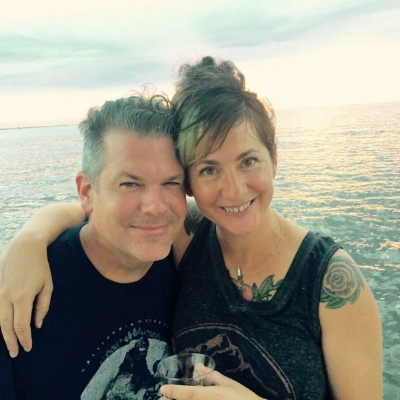 Monica and Neil, drinking wine out of plastic cups while enjoying a sunset cruise on Lake Pontchartrain.