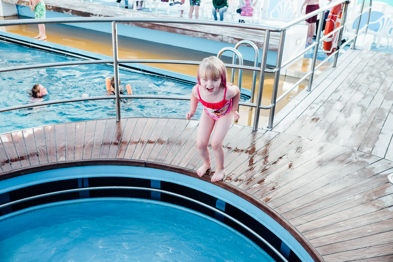 Willow jumping in to the paddling pool, bigger pool behind © Andrew Newson