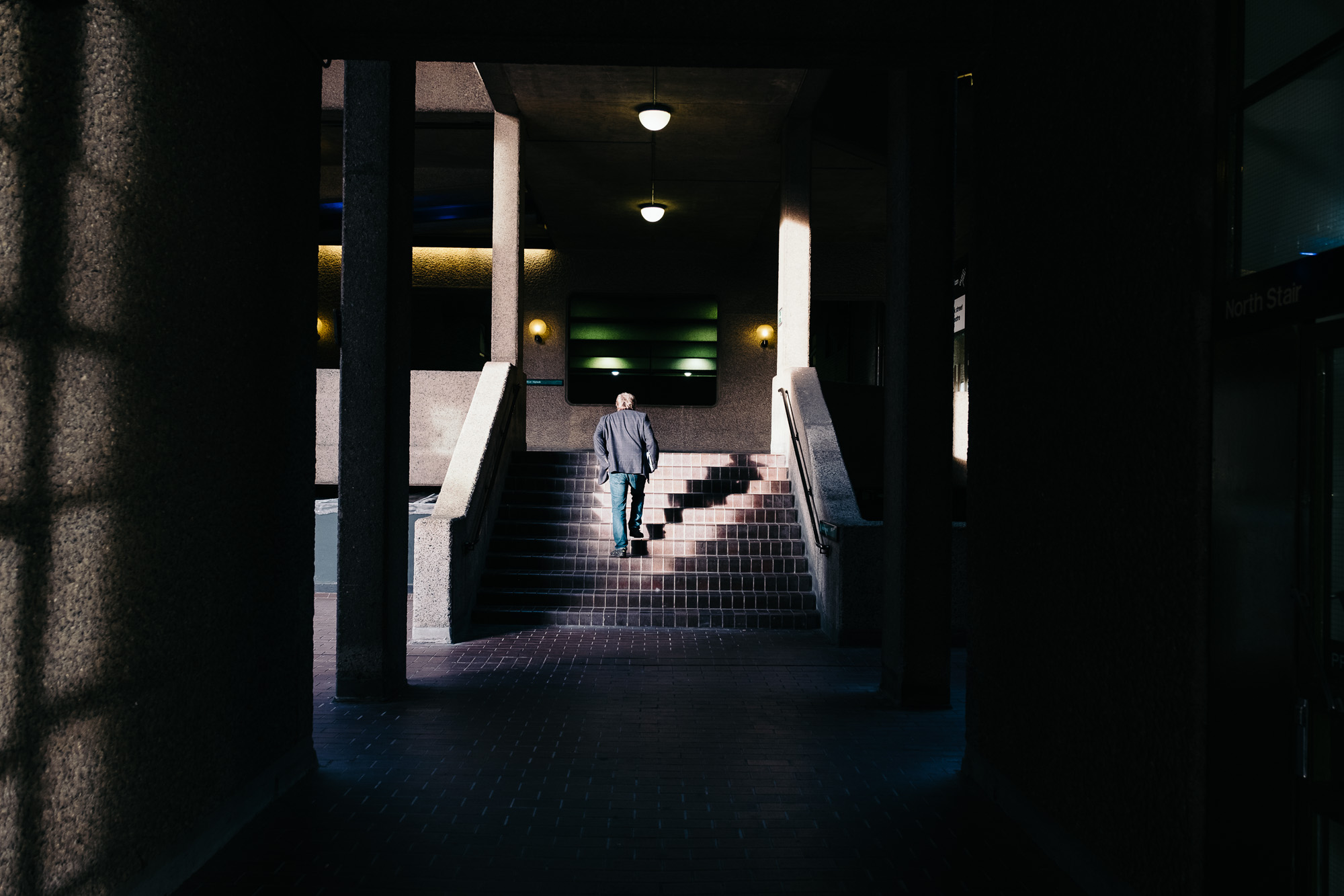 Man on stairs, Barbican Centre © Andrew Newson