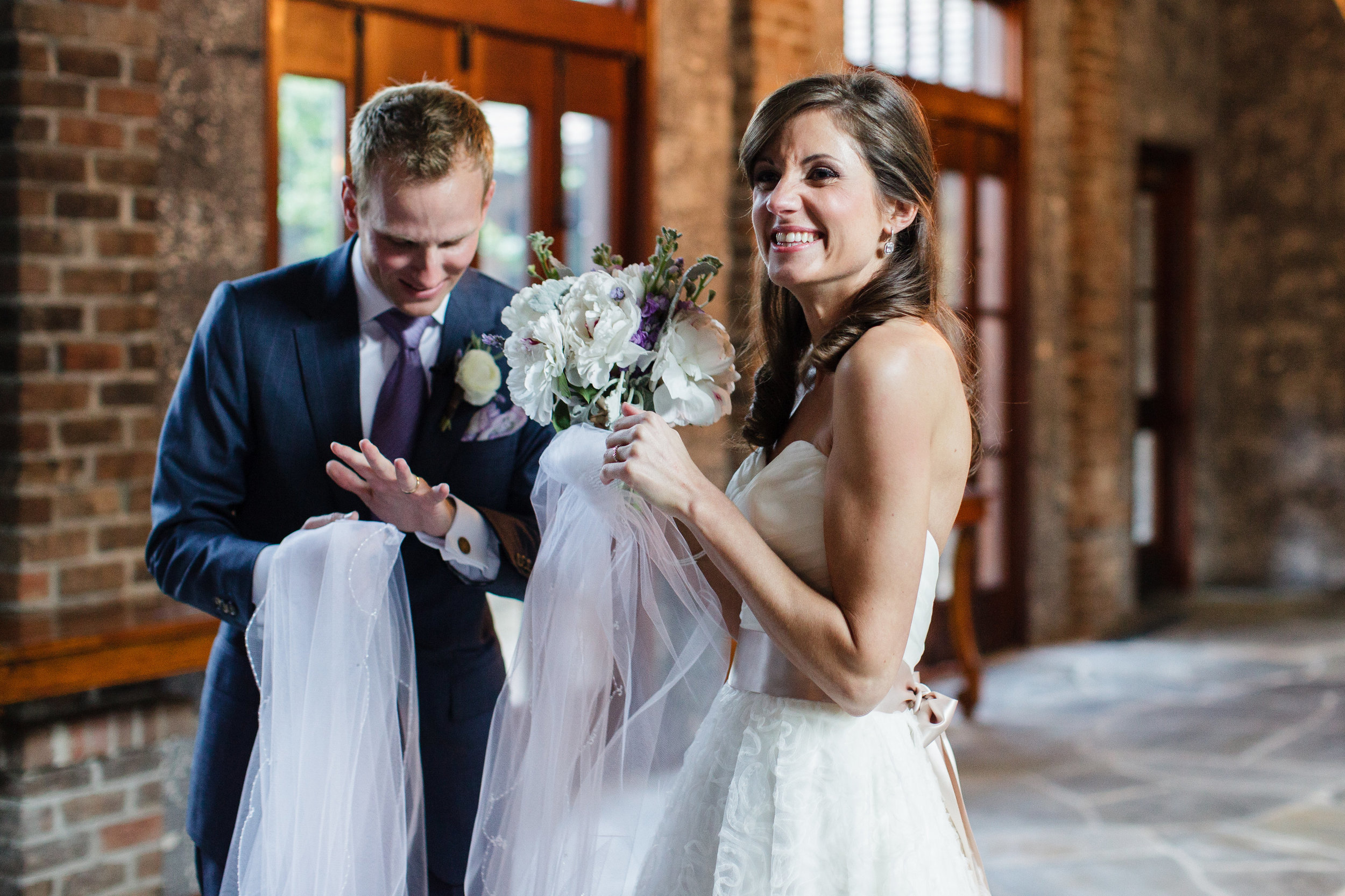 I love this first-married moment right after we walked back down the aisle as husband and wife. I feel like our excitement could just leap off the page!   Photo by Sarah DeShaw Photography