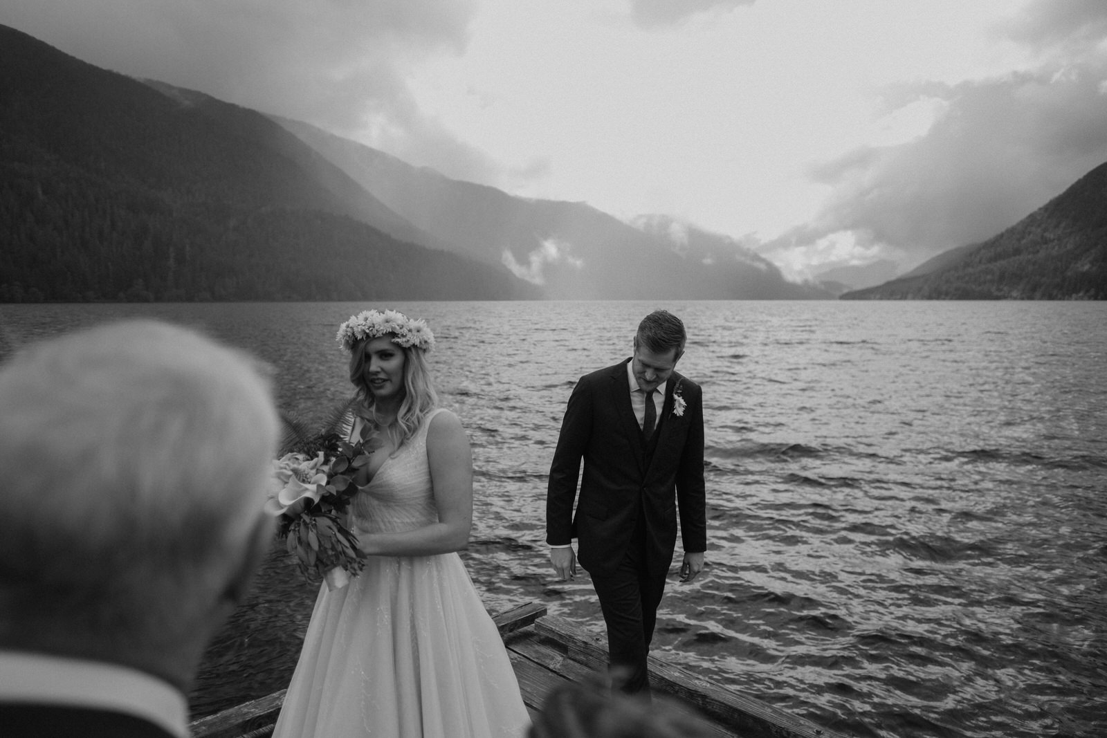 bride and groom at the shore of lake crescent lodge