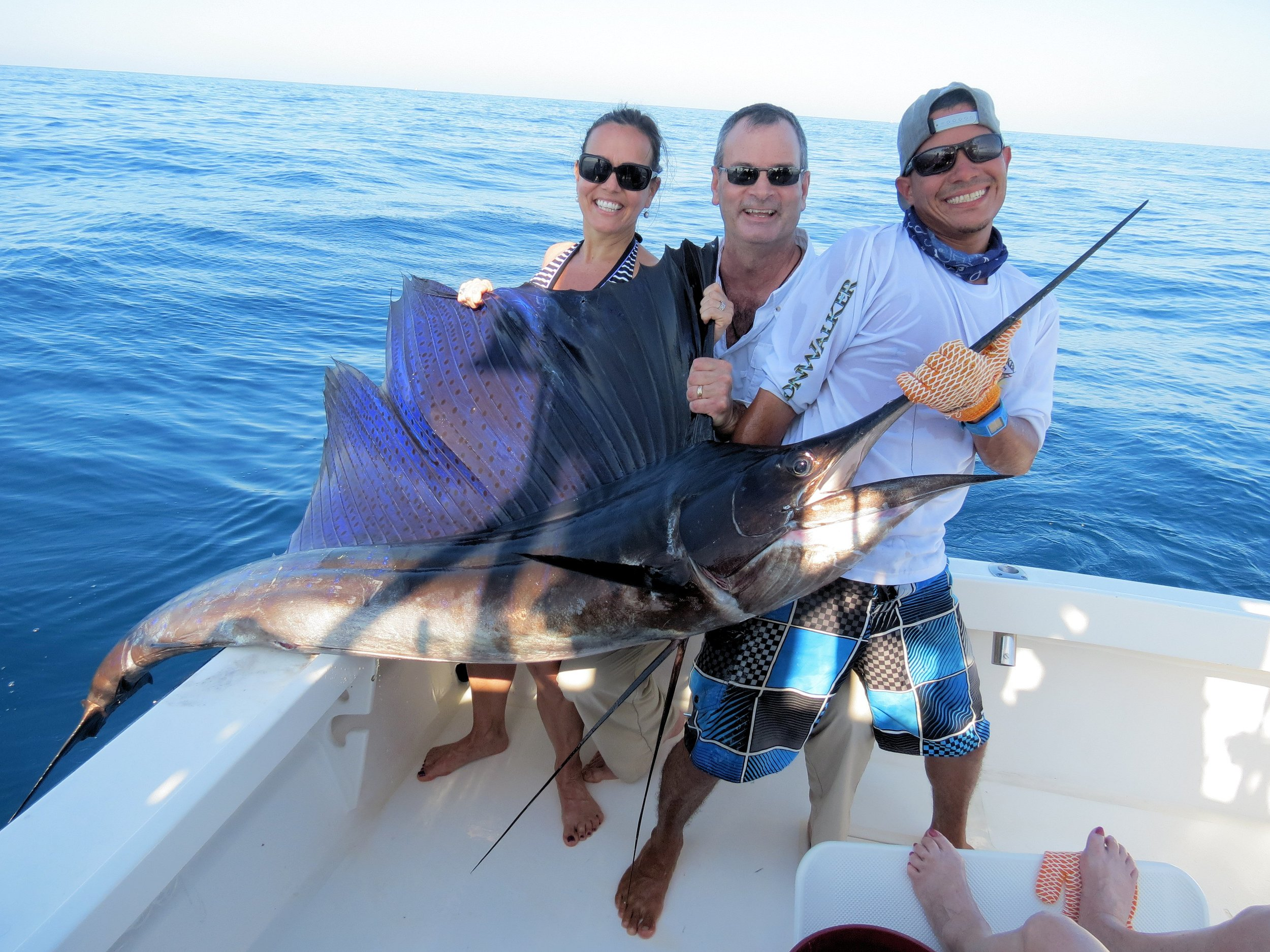 Rosanna and Joe O'Donnell, with Kelvin and Joe's jumbo sailfish