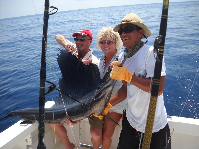Dennis Souva, Cindy Baker and Mate Keller with one of 9 sailfish boated by the Moonwalker on February 5th.