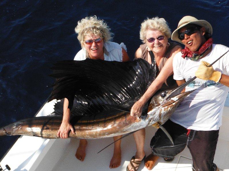 Cindy Baker, Helga Bertsch and mate Keller with one of nine sailfish boated by the Moonwalker on Feb. 5th. Cindy baker boated two of the nine sailfish.