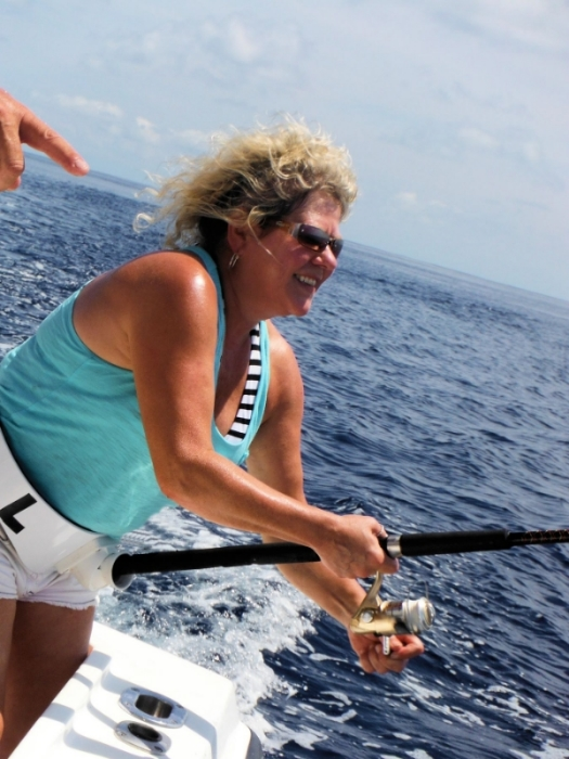 Cindy baker fights an aggressive sailfish with a spinning rod and 12lb. test. Cindy wins!