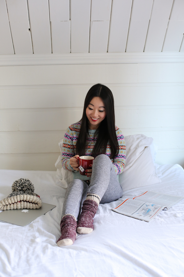 Outfit:  Roots Skinny Cozy Sweatpants ,  J. Crew fair isle sweater ,  Roots Cabin Collection socks ,   Roots Chunky Cabin Toque .  Mug :  Le Creuset ; Tea: Might Leaf Tea Earl Grey ; Lips:  LAURA MERCIER Creme Smooth lipstick