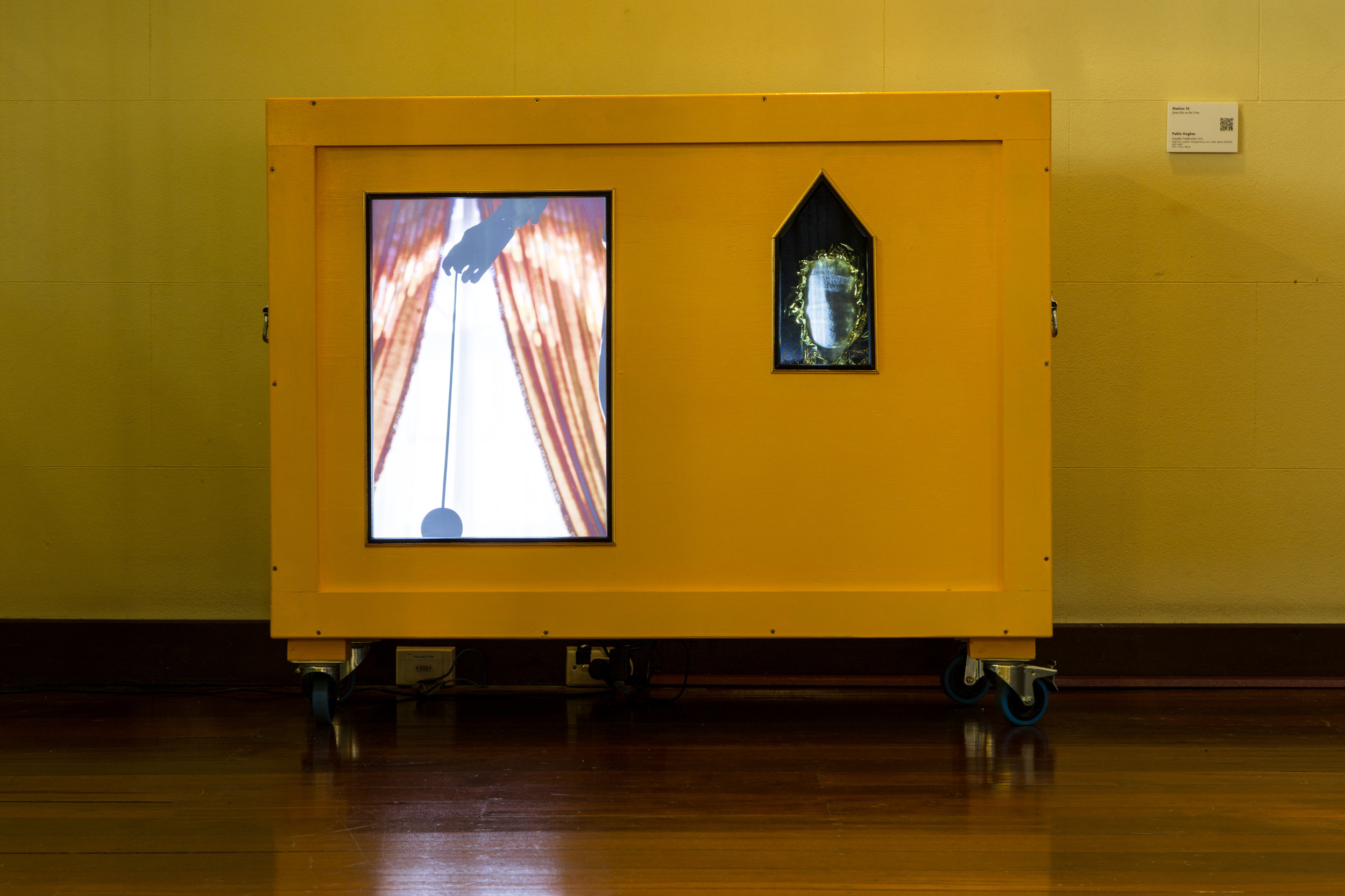 Station 12: Jesus Dies on the Cross  Pablo Hughes  Deadly Confessions  2016, Light box, paper, transparency (Kodak), art crate, space blanket and mesh 120 x 143 x 58cm