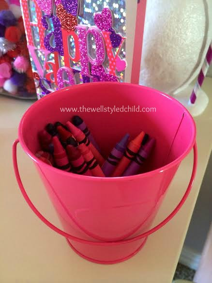 I pulled out all of her pink, red and purple crayons to put in this little bucket.
