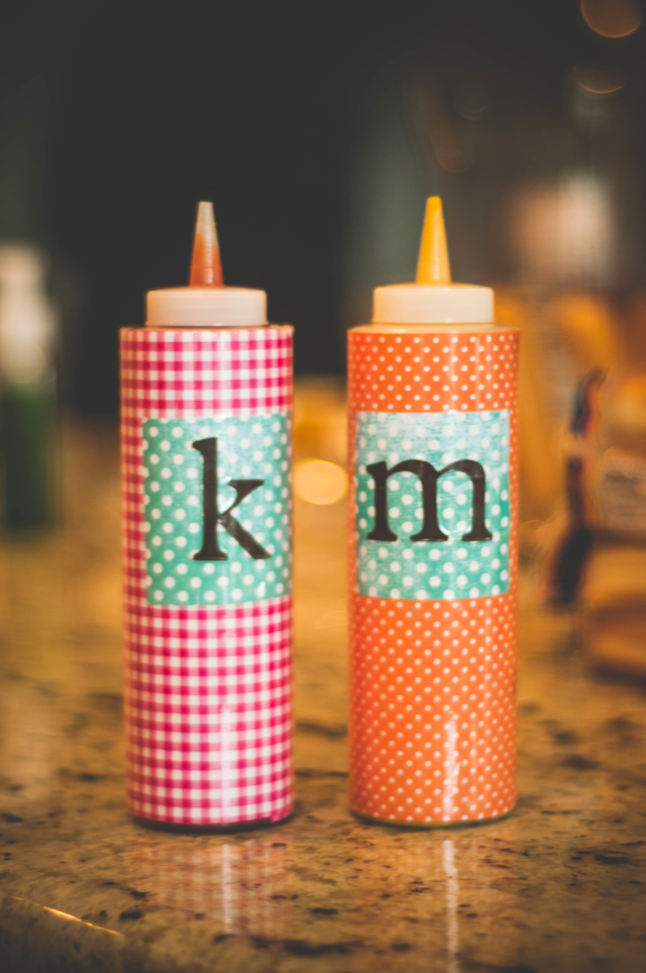 You can buy these condiment bottles for $1 or $2-- I covered in paper that matched our party and added initials also cut out on the cricut and then wrapped the whole thing in clear packing tape.