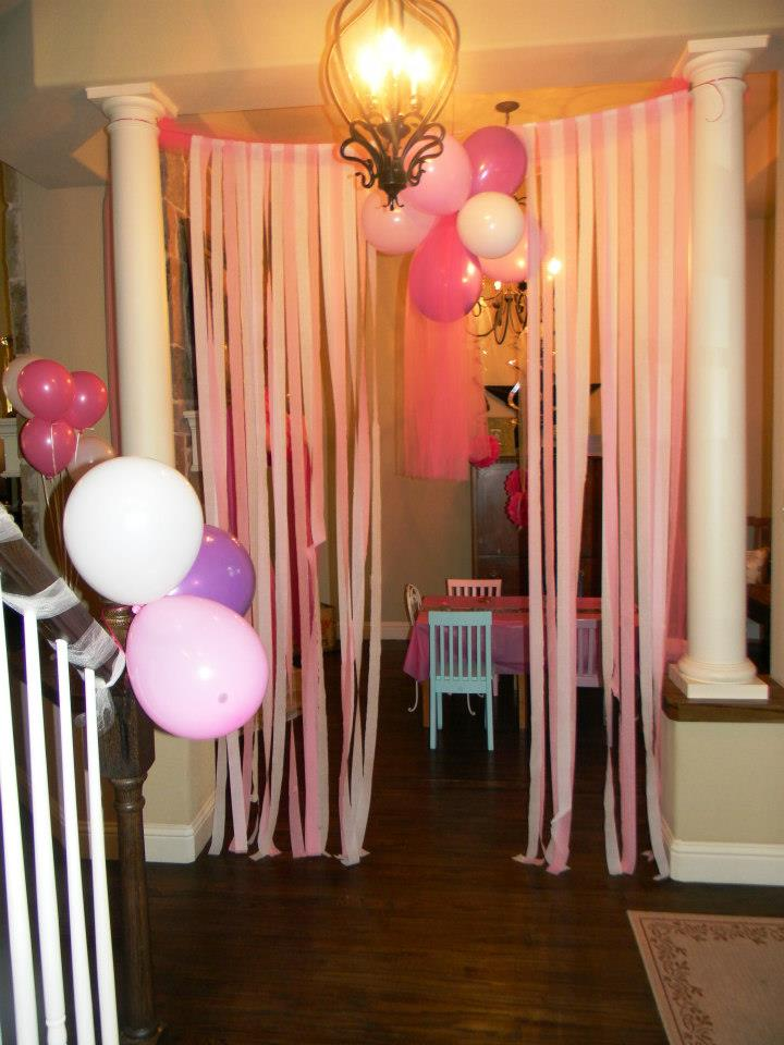 I love how my sister focused her decor in her formal dining room for my niece's princess party! They tied tulle around the columns and then hung long strips of crepe paper making a curtain fit for a princess!