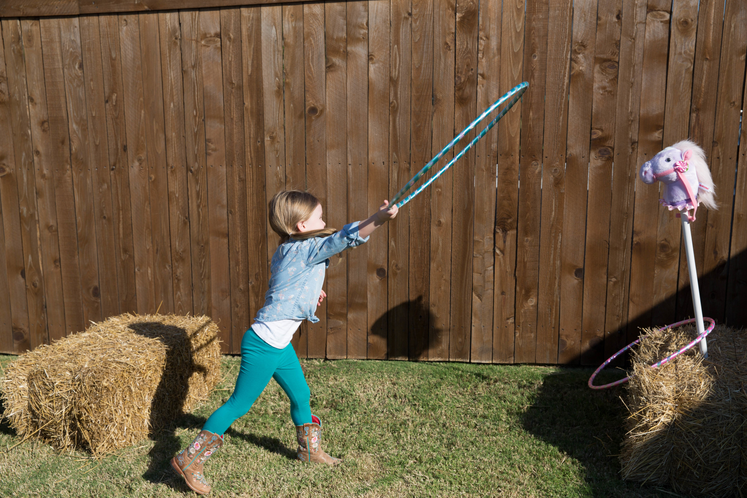 Taysen makes the perfect cowgirl--look at her lasso that wild purple pony!
