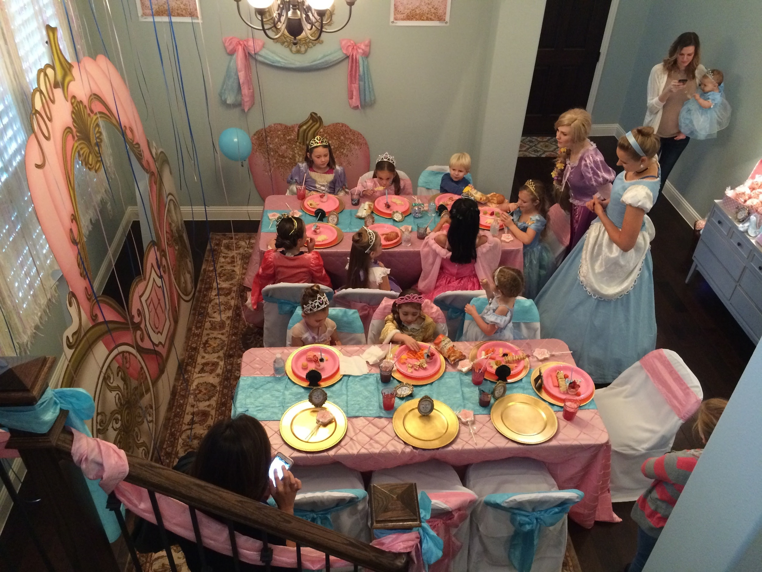The girls were just starting to get seated for lunch while our Royal Visitors, Princesses Rapunzel and Cinderella entertained them with songs, stories and games.  If you're in the Dallas Fort Worth area, I booked these ladies through  Royally Fun Parties  and they were AMAZING!!!!  I cannot say enough good things.  They seriously jumped right in and helped with games, crafts, helped the girls get lunch and were like having two extra hostesses at the party.  Best of all they had beautiful voices and the girls were SO entertained!  It was seriously magical!