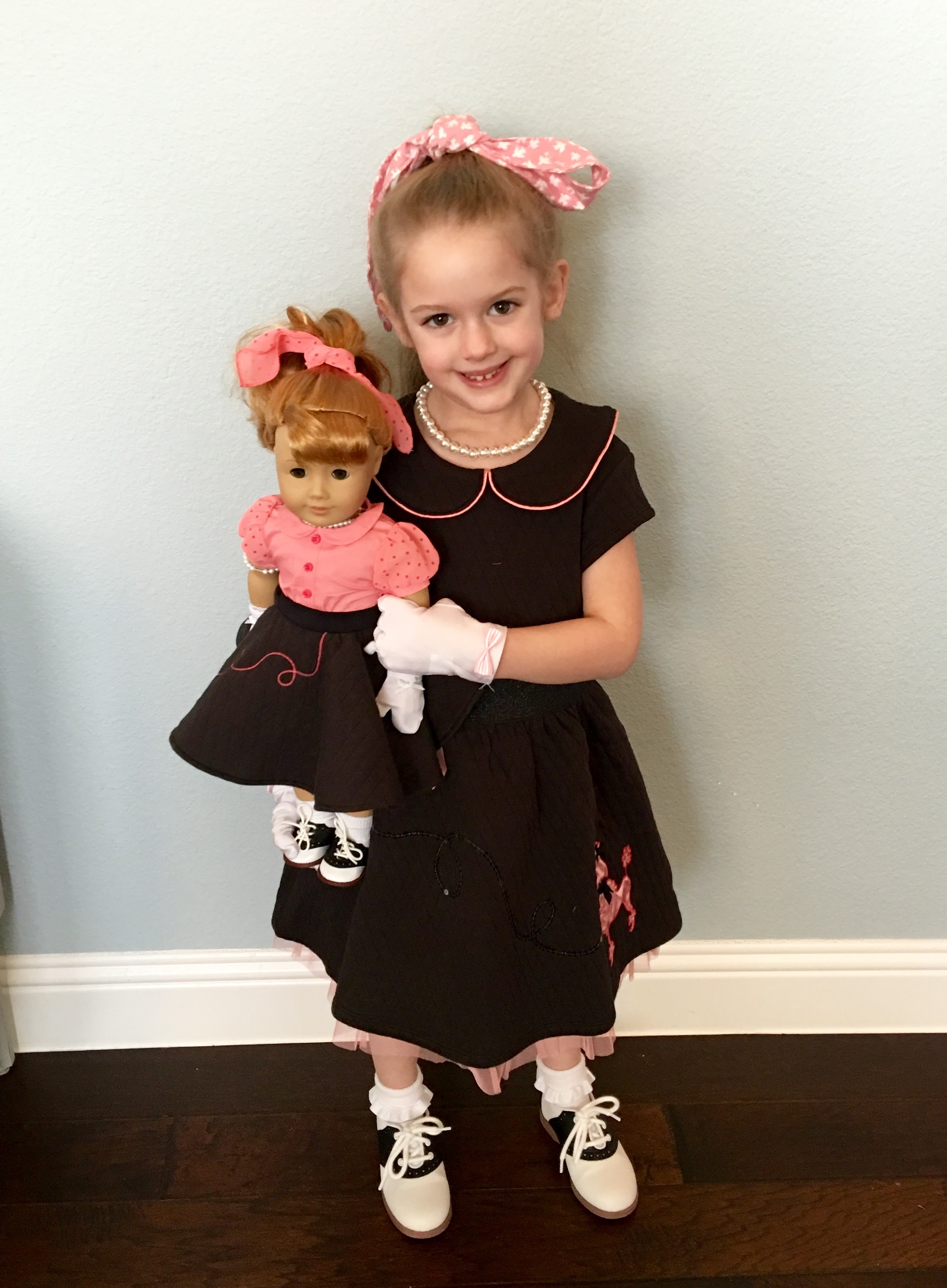 Holiday with her 1950's era Maryellen BeForever American Girl Doll along with a coordinating girl outfit also from American Girl