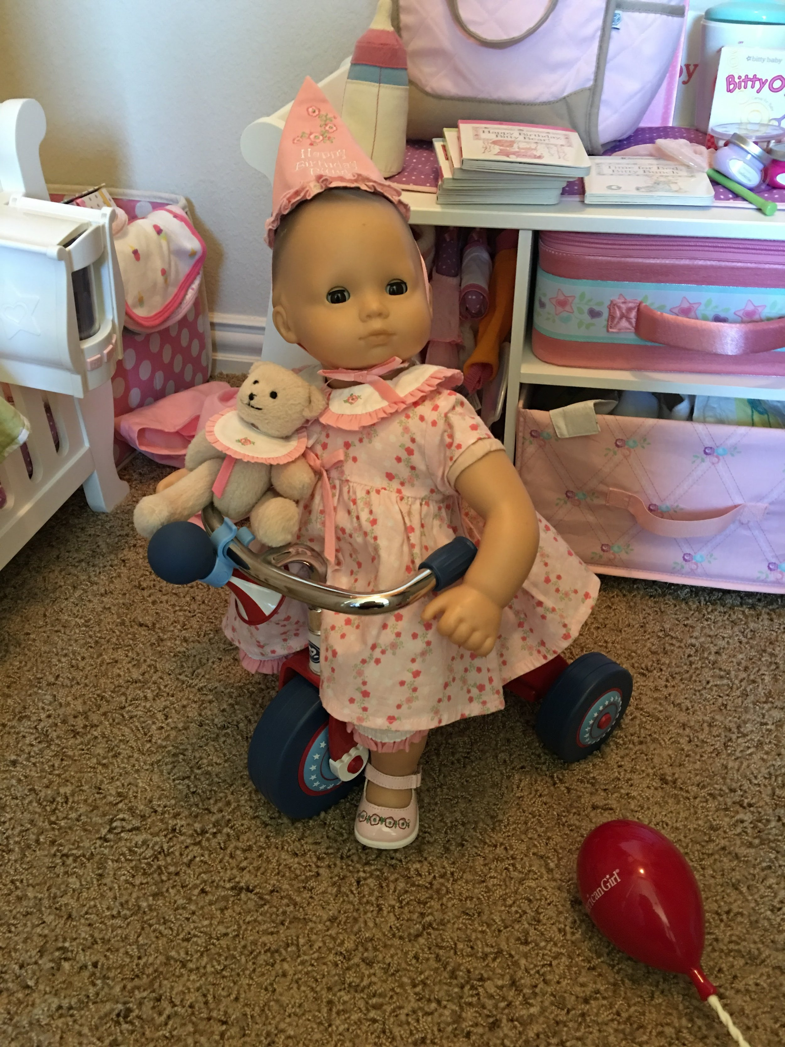 American Girl Bitty Baby on her tricycle in her (retired) birthday outfit!  A perfect example of timeless, classic toys and keeping little girls little!