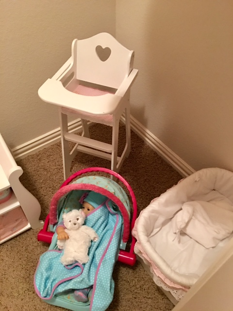 On the right side we have Bitty's Travel Seat another heirloom wooden cradle I've had for years and a wooden doll high chair.