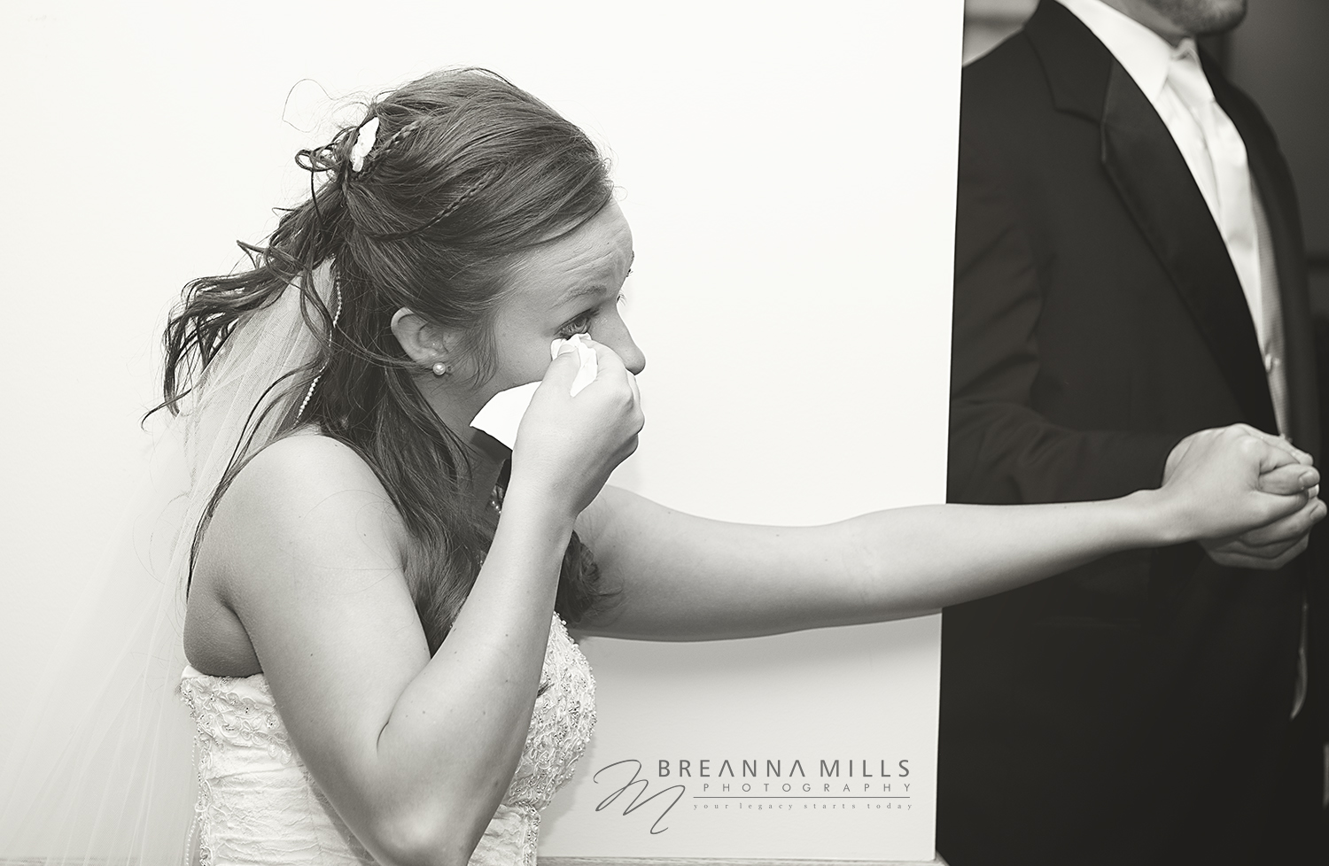Johnson City Photographer, Breanna Mills Photography captures and emotional bride with her groom on their wedding day.