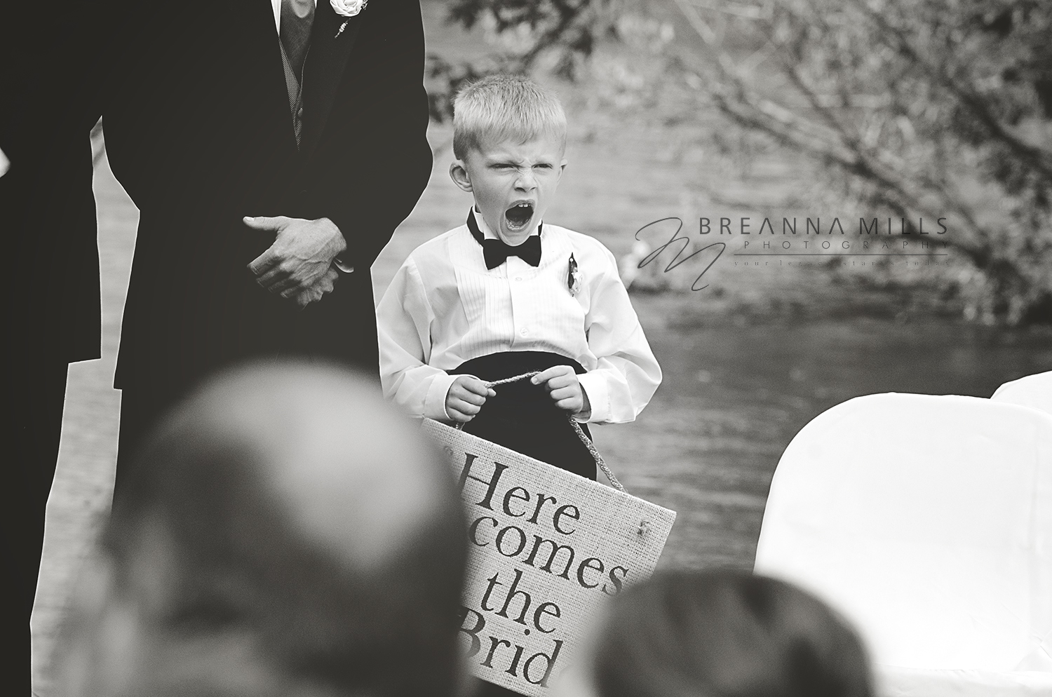Johnson City wedding photographer, Breanna Mills Photography captures ring bearer at wedding ceremony.