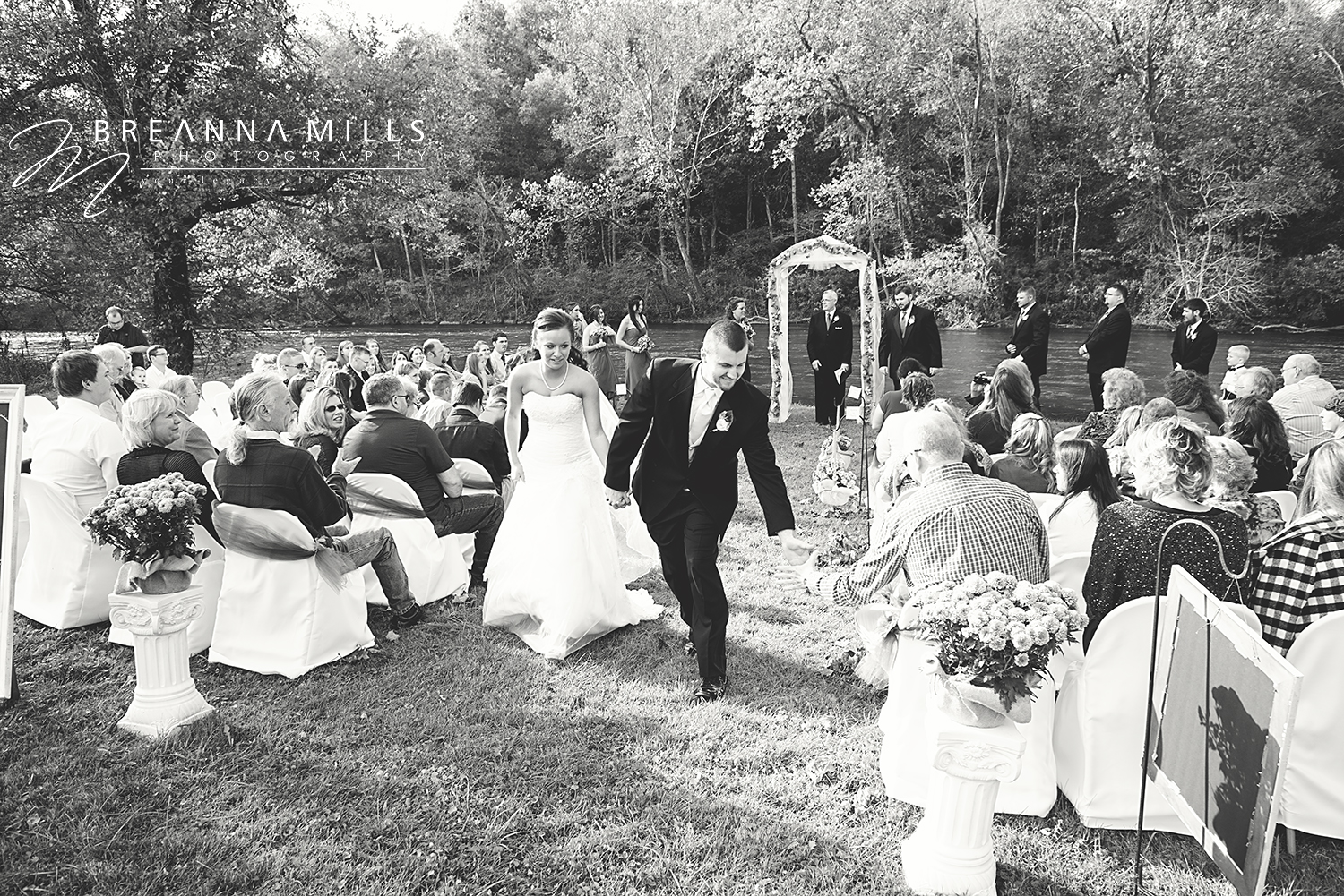 Johnson City wedding photographer, Breanna Mills Photography captures a spontaneous high five on bride and grooms wedding day.
